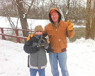 SPECIAL TO THE VINDICATOR Justin Lemmon, left, was the Junior Race winner on Jan. 1 at the Olde Dutch Mill Golf Course 5th Annual Duck Race in Lake Milton. He attended with his grandfather Bill Lemmon.