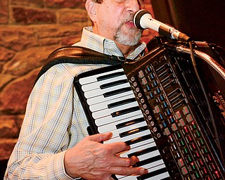 Jim Frank of the Jim Frank Trio sings and plays the accordion during a winter concert recently at Yellow Creek Park in Struthers.