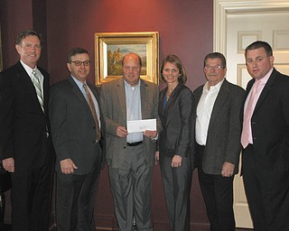 Bill Strimbu, president of Nick Strimbu Inc. and a founder of the Strimbu Memorial Fund, received a check for $22,000 from Melissa Scheffler of Chubb Insurance. A team sponsored by the HDH Group placed seventh in a national golf tournament and donated its winnings to the Strimbu Fund. From left to right are Steve Leon, HDH Group; Jim Grasso, Liberty Steel and vice president of the Strimbu Fund; Strimbu; Scheffler: Paul O'Brien of Rien Construction and president of the Strimbu Fund; and Joe Totten of the HDH Group. 