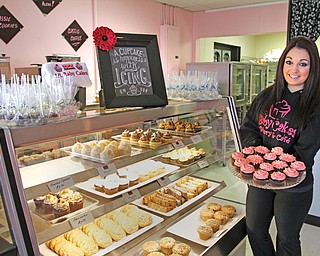 Lil Baby Cakes opened earlier this month, making things sweeter in Canfield. Alexa Diana, 19, of Austintown takes pride in her perfectly iced cupcakes and cakes.