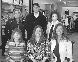 SPECIAL TO THE VINDICATOR  Promoting the 10th annual champagne brunch and fashion show planned Feb. 28 by Mahoning County Medical Society Alliance are, seated from left, Cassi Calderon, Katie Altenhof and Susan Yarah, and standing, Carol Sankovic; Patrick Sankovic, who will be among the models; and Gloria Detesco.
