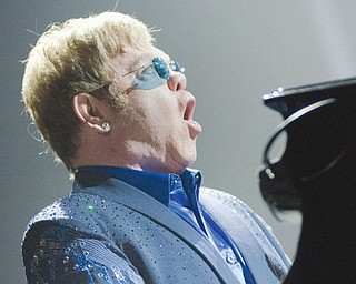 "Elton John sings ''Funeral for a Friend/Love Lies Bleeding"" during the opening of his concert at the Covelli Centre on Saturday night."