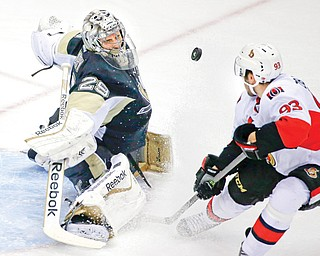 Pittsburgh Penguins goalie Marc-Andre Fleury (29) makes a save on a shot by Ottawa Senators' Mika Zibanejad