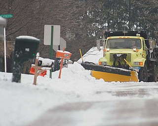 A Boardman road department truck plows snow from Spring Garden Drive on Wednesday afternoon after Mother Nature dumped another several inches of snow on the Mahoning Valley on Tuesday night into Wednesday. Many road departments across the Valley are dealing with dwindling road salt supplies because of the long winter.
