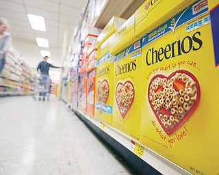 Boxes of Cheerios are seen on a store shelf in Akron, N.Y. Large food companies are trying to head off state-by-state efforts to enact mandatory labeling of genetically modified ingredients by proposing new voluntary labels nationwide.