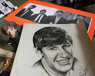 ROBERT K. YOSAY  | THE VINDICATOR..The Beatles 50 years later ..Linda Linonis and her cousin, Patti Albert, saw the Beatles at Cleveland Auditorium; they have some Beatles memorabilia and ticket stubs from that concert........ - -30-.
