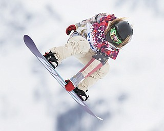 Jamie Anderson of the United States takes a jump on her first run in the women's snowboard slopestyle final Sunday at the 2014 Winter Olympics in Krasnaya Polyana, Russia.
