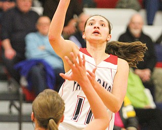 Fitch's Megan Sefcik (11) shoots over Lakeview's Alli Pavlik (15) during Monday's game in Austintown. The