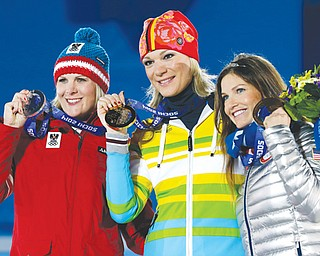Women's super-combined medalists, from left, Nicole Hosp of Austria, silver, Maria Hoefl-Riesch of Germany, gold, and Julia Mancuso of the United States, bronze, pose with their medals at the 2014 Winter Olympics in Sochi, Russia on Monday.
