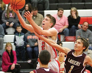 Girard's Jim Standohar (2) goes to the basket as Pymatuning Valley's Aaron Cross, right, defends Tuesday night. The Indians, of the All-American Conference, beat the Lakers, of the Northeastern Athletic Conference, 68-55.