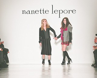 Fashion designer Nanette Lepore, left, brings her daughter Violet on the runway after showing her Fall 2014 collection during New York Fashion Week on Wednesday.