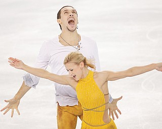 Tatiana Volosozhar and Maxim Trankov of Russia celebrate after finishing their routine in the pairs free skate competition Wednesday during the 2014 Winter Olympics in Sochi, Russia. The pair took the gold medal, and the silver went to Russian teammates Ksenia Stolbova and Fedor Klimov.