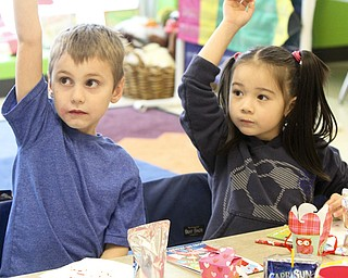 William D Lewis The vindicator Austown Elem school kindergarten students Zachary Stipanovich and Eva Toropal raise their hands during a Valentines Day  party at the school 2-13.
