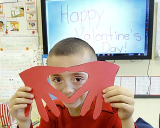 William d Lewis The Vindicator  Austintown Elem School kindergarten student Nicholas Beatty shows off a Valentines craft project he made during a Valentines party 2-13 at his school.
