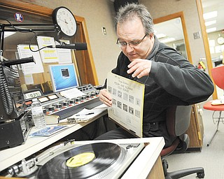 "Dennis Spisak, host of ""The Slovak Program,"" gets ready to spin a record after a request Saturday night. Spisak has hosted the show, which runs from 9 to 11 p.m. Saturdays, for the past four years but also played polkas on WKTL 90.7 FM as a student at Struthers High School."