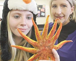Boardman High School student Megan Banks, left, takes a look at a starfish along with biology teacher Heather Moran. Megan is part of the school's team that will compete in the National Ocean Sciences Bowl. Moran, who also teaches Earth science, chemistry and physics at BHS, serves as the team's coach.