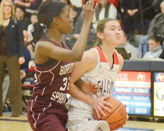 Boardman's Jada Redd closely guards Fitch's Megan Sefcik during their Division I sectional basketball game Monday at Fitch High School in Austintown. Sefcik and teammate Cassie Custer each scored 19 points for the Falcons, who pulled past the Spartans, 65-62.