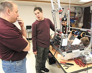 Bobby Hudock, a sophomore at Canfield High School, asks teacher Don Crum about the robot he's constructing for the FIRST Robotics Competition. The robotics team at Canfield used Tuesday's snow day to perfect their work, which was due by day's end.