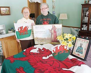 Images of St. David, daffodils and the Welsh flag and shield will be on display at the St. David's Day banquet being planned by Rhea Crelin, left, coordinator, and John Tamplin, president of the St. David's Society of Youngstown. The banquet March 1 celebrates Welsh heritage and the patron saint of Wales.
