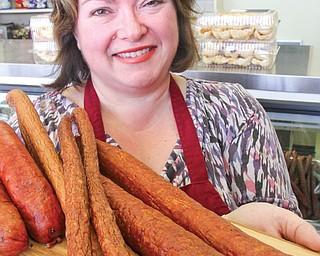 Marta Mazur, owner of Krakus Polish Deli and Bakery in Boardman, shows a sampling of the deli's popular kielbasa.
