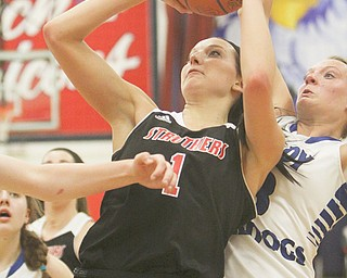 Ashleigh Ryan of Struthers puts in a layup against Lakeview defender Abby Pavlik during the second half of their Division II district semifinal on Monday at Fitch High School in Austintown. Ryan recorded a game-high 19 points with nine rebounds to help lead the Wildcats over the Bulldogs, 53-39. Struthers faces the winner of tonight's West Branch-Ravenna contest in the district title game Friday.