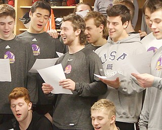 "American members of the Youngstown Phantoms hockey team sing ""O, Canada"" before Tuesday's practice for teammate Bo Pellah and assistant coach Brad Patterson, both of whom are from Canada. The players and coach made a wager on Olympic hockey in which the losers had to sing the other country's national anthem."