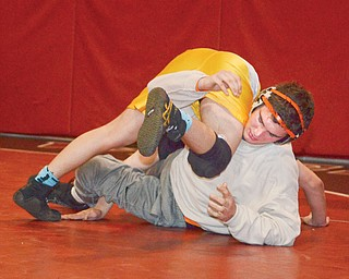 Howland wrestler David-Brian Whisler, bottom, practices with Canfield's Georgio Poullas during wrestling media day on Tuesday at Canfield High School. Whisler, who will compete this weekend in Division II, is looking to improve on his fourth place finish at last year's state tournament.