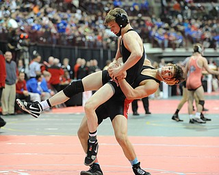 Georgio Poullas of Canfield goes for the slam of Luke Leonard of Fostoria during their 126lb Division 2 championship bracket bout during the State High School Wrestling meet on February 27, 2014 at Jerome Schottenstein Center in Columbus, Ohio.