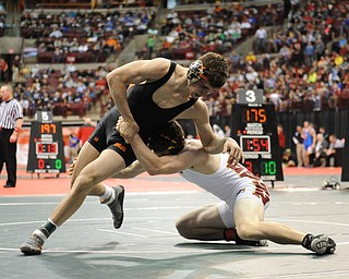 David-Brian Whister of Howland slips out of a takedown attempt from Andrew Dunn of Hamilton Ross during their 152lb Division 2 championship bracket bout during the State High School Wrestling meet on February 27, 2014 at Jerome Schottenstein Center in Columbus, Ohio.