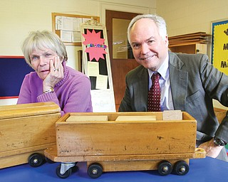 Ginny Meloy , director of Poland Presbyterian Weekday Preschool from 1984 to 1999, and the Rev. David Gilbert, pastor of Poland Presbyterian Church, sit in one of the preschool classes, where a wooden toy train from 1958 remains a fixture. The preschool will be re-launched in September after a year off. A summer camp also is planned.