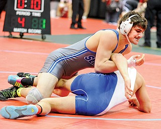 Poland's Mike Audi rolls over Tye Smith of Washington Court House for the pin in their match in the 170-pound weight class of the Division II state wrestling tournament Thursday in Columbus. Audi was one of eight local wrestlers to advance on Day 1 of competition and the only local to record a pinfall.