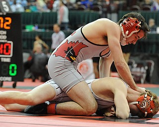 COLUMBUS, OHIO - FEBRUARY 28, 2014: Korey Frost of Canfield rides the back of Dustin Warner of Uhrichsville Claymont during their 120lb championship bracket bout during the 2014 division 2 state wrestling tournament at Schottenstein Center.