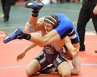 COLUMBUS, OHIO - FEBRUARY 28, 2014: Mario Graziani of Boardman attempts to get out from between the legs of Bo Ransom of Madison during their 145lb consolation bracket bout during the 2014 division 1 state wrestling tournament at Schottenstein Center.