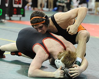 COLUMBUS, OHIO - FEBRUARY 28, 2014: David-Brian Whisler of Howland prepares to take the back of Reyse Wallbrown of Indian Valley during their 152lb consolation bracket bout during the 2014 division 2 state wrestling tournament at Schottenstein Center.