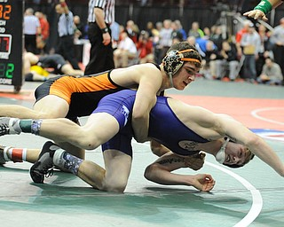 COLUMBUS, OHIO -FEBRUARY 28, 2014: David-Brian Whisler of Howland controls the back of Mike Repko of Vermilion as he attempt to crawl out of bounds during their 152lb championship bracket bout during the 2014 division 2 state wrestling tournament at Schottenstein Center.