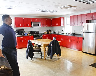 ROBERT K. YOSAY  | THE VINDICATOR..Captain Perry Harrison in the new dining room area ..YFD newest station on Midlothian- has two bays - living area - dorm area - bathrooms with showers - ..The new station is in the 1600 block of East Midlothian. It is 4,800 square feet and cost just under $1 million to build..It replaces a station from the 1930s at Midlothian and Sheridan that needed major repairs.