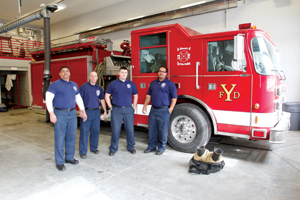Members of the Youngstown Fire Department are happy about the new Station No. 9 on East Midlothian Boulevard on the city's South Side. At the top, from left, are Capt. Perry Harrison, William Palma, Jeff Goodlet and Lt. Chris Brown.
