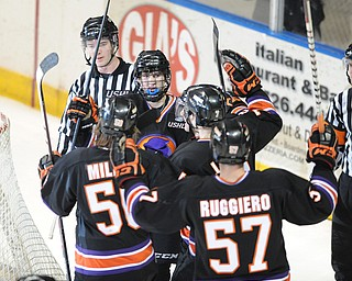 YOUNGSTOWN, OHIO - MARCH 21, 2014: Trey Bradley #10 of the Phantoms is congratulated by his teammates #50 Matt Miller, #57 Steven Ruggiero, #7 Maxim Letunov, and #8 Josh Melnick after scoring the 5th goal of the game during the 2nd period of Friday morning against Team USA at the Covelli Centre. The Phantoms won 7-3.