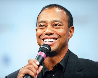 Tiger Woods speaks at a news conference at the Newseum in Washington on Monday during an announcement for the Quicken Loans National at Congressional in Bethesda, Md., in June. Woods is unsure if his ailing back will allow him to play in The Masters in two weeks.