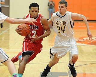 HOWLAND, OHIO - MARCH 25, 2014: Quincy Higgins #22 of Fitch dribbles to the basket inside of Brandon Lee of Bristol during Tuesday nights Frank Bubba Classic boys basketball all-star game at Howland High School.