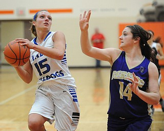 HOWLAND, OHIO - MARCH 25, 2014: Alli Pavlik #15 of Lakeview looks to the basket while being guarded by Kelsie Settle #14 of Sebring during the second half of Tuesday nights Frank Bubba Classic girls basketball all-star game at Howland High School. Mahoning County won  67-62.