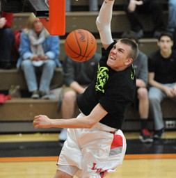 HOWLAND, OHIO - MARCH 25, 2014: Peyton Aldridge #10 of Labrae slams the ball home during the boys slam dunk contest before of Tuesday nights Frank Bubba Classic boys basketball all-star game at Howland High School.