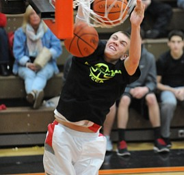 HOWLAND, OHIO - MARCH 25, 2014: Peyton Aldridge #10 of Labrae slams the two balls home during the boys slam dunk contest before of Tuesday nights Frank Bubba Classic boys basketball all-star game at Howland High School.
