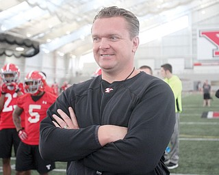 Youngstown State head football coach Eric Wolford watches Tuesday's practice at YSU's WATTS. Wolford will be overseeing the team for an additional two years once the details of his contract extension are ironed out.