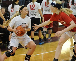 David W. Dermer | The Vindicator.BOARDMAN, OHIO - MARCH 26, 2014: Jenna Kuczek #33 of Boardman looks to pass the ball while Sarah Cash #20 of Loardstown plays defense during the 2014 Al Beach All Star game Wednesday night at Boardman High School. ..