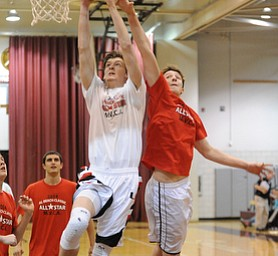 David W. Dermer | The Vindicator.BOARDMAN, OHIO - MARCH 26, 2014: Andrew Midgley #11 of Canfield attempts to dunk over Zac Hagy #6 of Mineral Ridge during the 2014 Al Beach All Star game Wednesday night at Boardman High School.