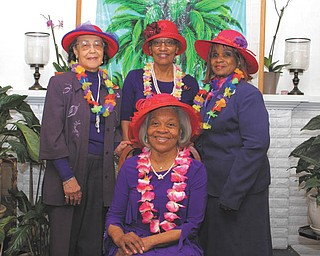 SPECIAL TO THE VINDICATOR String of Pearls members of the Red Hat Society are preparing for its eighth annual luncheon April 9. Seated is Betty Crafter, royal queen mother; and standing, from left, are Carol Donnelly, founding queen; Erma Hart, reservations chairwoman; and Catherine Leftwich, vice queen.