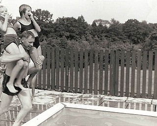 This picture was taken around 1966 by Vera Perun of Monaca, Pa. It includes her daughter, Paula Cavoulas of Canfield, and her cousin Linda Davis Dukavich of Hopewell Twp, Pa. on Paula's dad's shoulders as they are about to take the plunge. Paula's Dad is George Perun.