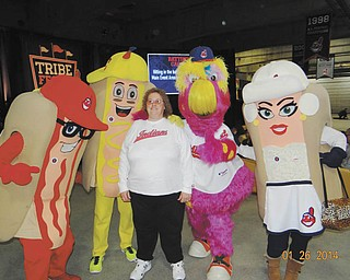 This is Shelly Toth of Austintown with the Cleveland Indians mascots Slider and the Hotdogs, looking forward to opening day. Her husband, Jeff, took this in January at the Tribe Fest at Progressive Field.