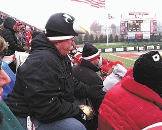 Harold Wilson of Austintown was at the last YSU home game of the 2013 season, just as the snow started falling. He is a BIG BIG fan and will watch those Penguins in any kind of weather. Harold is a retired teacher, and his wife, Kay, who submitted the photo, is a school secretary.